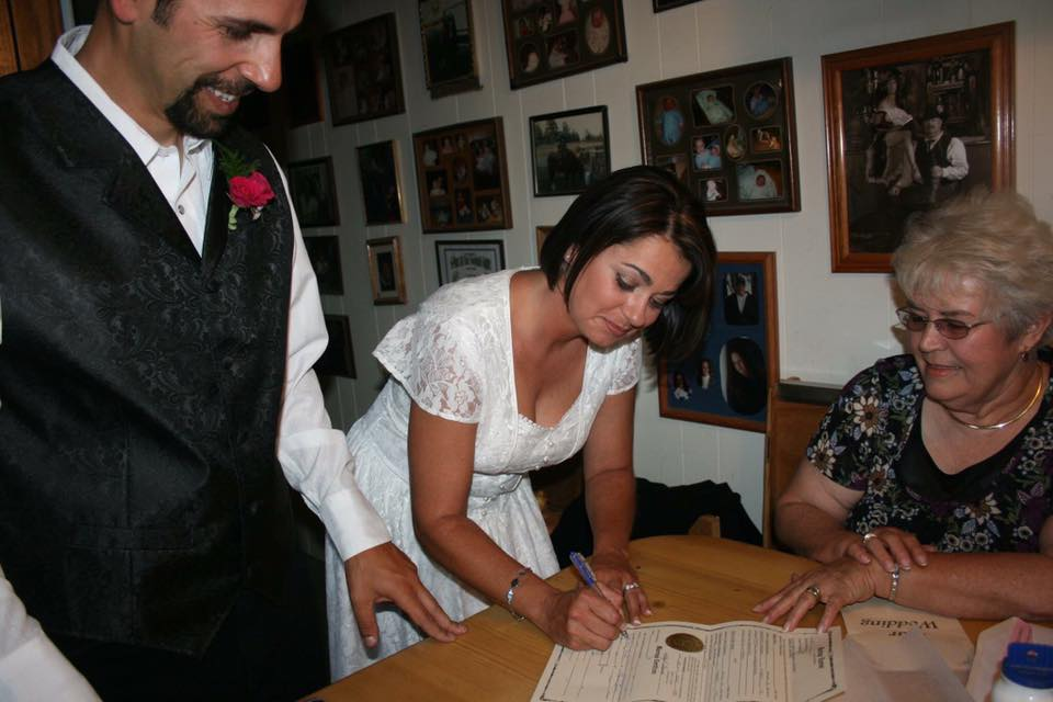 Angela and I signing our marriage license in 2008 in the great state of Montana